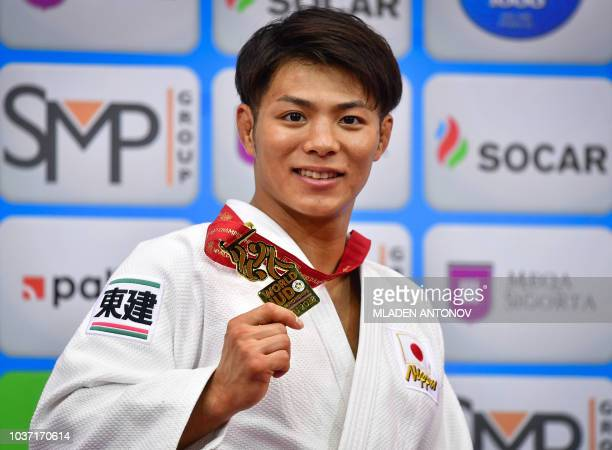 Japan's Hifumi Abe poses with his gold medal in the under 66kg men category of the 2018 Judo World Championships in Baku on September 21 2018