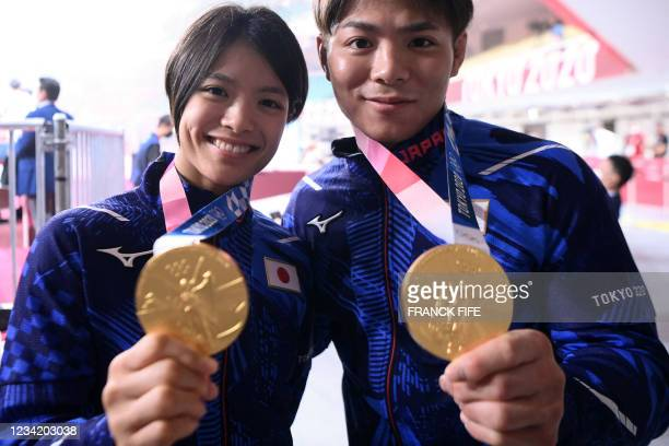 Japan's Hifumi Abe, the gold medallist of the judo men's -66kg contest of the Tokyo 2020 Olympic Games, and his sister Uta Abe, the gold medallist of...