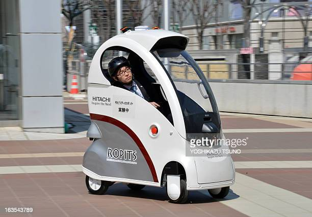 Japan's hightech maker Hitachi unveils the new mobility robot 'Ropits' in Tsukuba in Ibaraki prefecture on March 12 2013 The one man mobility robot...