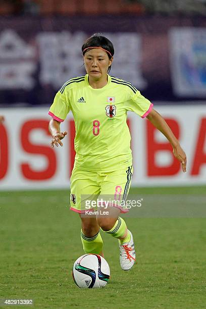 Japan's Hikaru Naomoto and Korea Republic's Cho So Hyun compete for the ball during EAFF Women's East Asian Cup 2015 final round at Wuhan Sports...