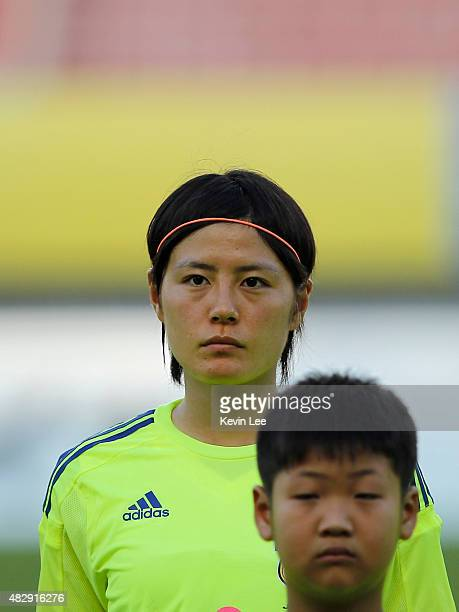 Japan's Hikaru Naomoto stands on the field before the match against Korea Republic during EAFF Women's East Asian Cup 2015 final round at Wuhan...