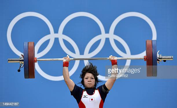 Japan's Hiromi Miyake competes during the women's 48kg group A weightlifting at the Excel Center during the 2012 Olympic Games in London on July 28,...