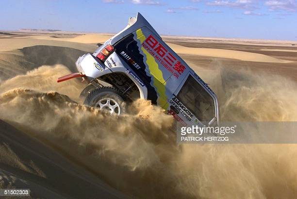 Japan's Hiroshi Masuoka passes a dune 22 january 2000, during the 16th stage of the 22th Dakar rally going from Dakhla to Wadi Rayan in Egypt....