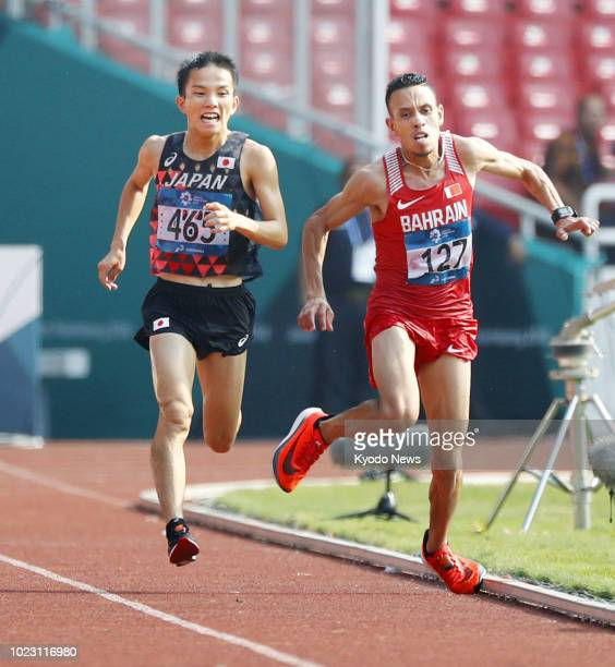 Japan's Hiroto Inoue competes against Bahrain's Elhassan Elabbassi en route to winning in the men's marathon at the Asian Games in Jakarta on Aug....
