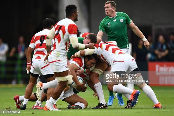 Japan's hooker Shota Horie is tackled during the Japan 2019 Rugby World Cup Pool A match between Japan and Ireland at the Shizuoka Stadium Ecopa in...