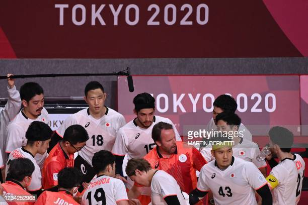 Japan's Icelandic coach Dagur Sigurdsson gives instructrions to his players during the men's preliminary round group B handball match between Japan...