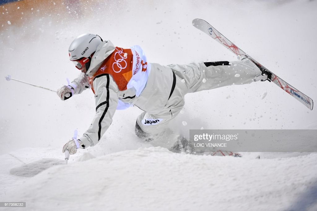 Japan's Ikuma Horishima crashes during the men's moguls final 1 during the Pyeongchang 2018 Winter Olympic Games at the Phoenix Park in Pyeongchang on February 12, 2018. /