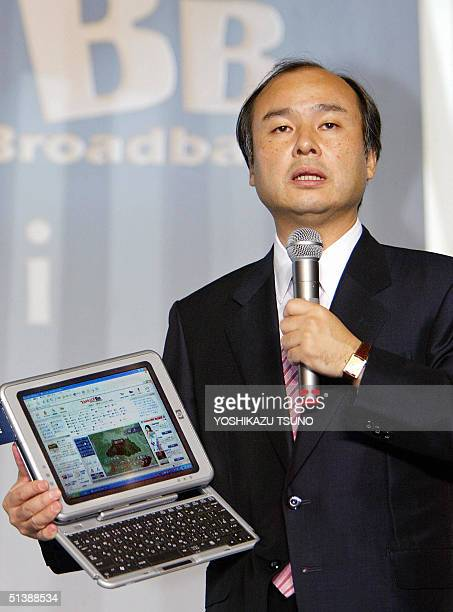Japan's Internet giant Softbank President Masayoshi Son announces the company will launch fiber to the home broadband services with maximum data...