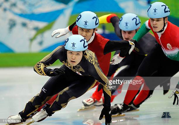 Japan's Jumpei Yoshizawa leads the group in the Men's 500 Meter qualifying heats during the 2010 Winter Olympics in Vancouver British Columbia...