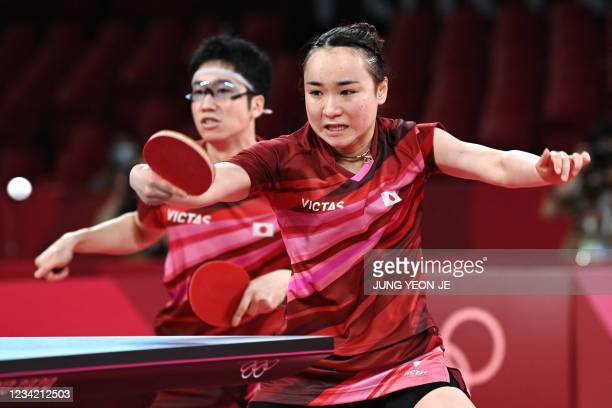 Japan's Jun Mizutani and Mima Ito compete against China's Xu Xin and Liu Shiwen in their mixed doubles table tennis final match at the Tokyo...