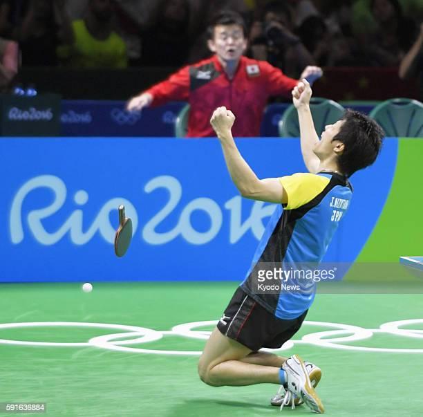 Japan's Jun Mizutani celebrates his win against China's Xu Xin during the men's table tennis team final at the Rio de Janeiro Olympics on Aug 17 2016...