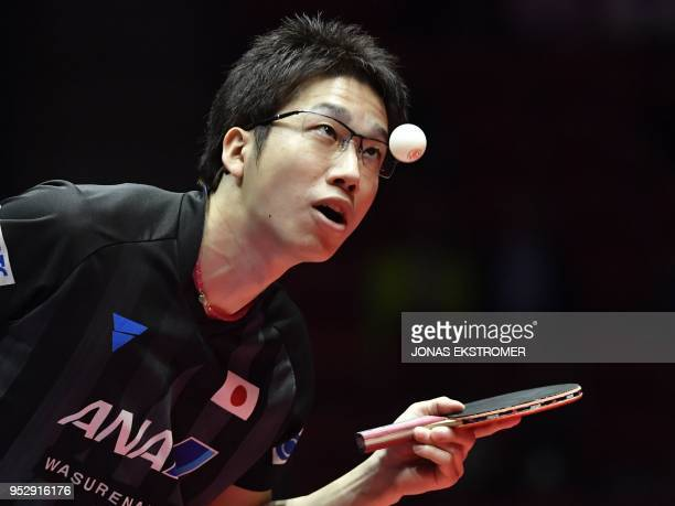 Japan's Jun Mizutani returns the ball to Belarus' Aliaksandr Khanin during the group C matchJapanBelarus at the World Team Table Tennis Championships...