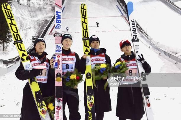 Japan's Junshiro Kobayashi Ryoyu Kobayashi Daiki Ito and Yukiya Sato pose for photos after finishing third in a World Cup men's team event in Lahti...