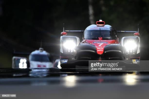 Japan's Kamui Kobayashi drives his Toyota TS050 Hybrid N°7 ahead Britain's Nick Tandy on his Porsche 919 Hybrid N°1 during the second qualifying...