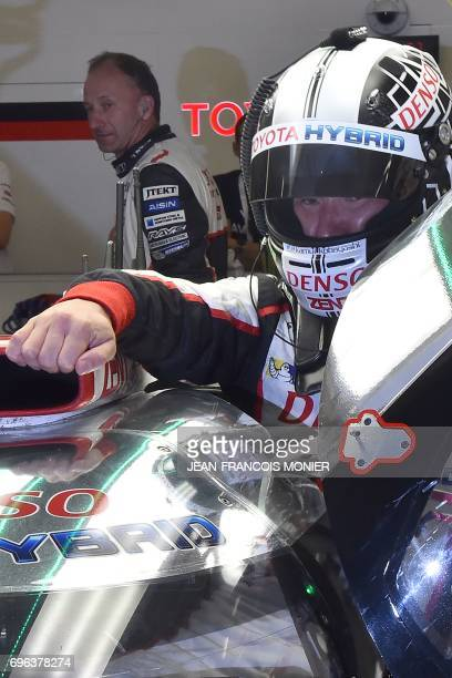 Japan's Kamui Kobayashi takes a relay on his Toyota TS050 Hybrid N°7 during the third qualifying practice session of the Le Mans 24 hours endurance...