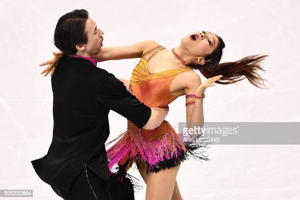 TOPSHOT Japan's Kana Muramoto and Japan's Chris Reed compete in the ice dance short dance of the figure skating event during the Pyeongchang 2018...