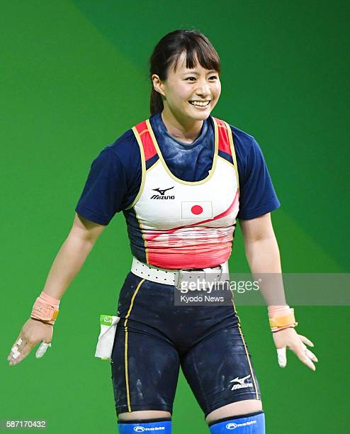 Japan's Kanae Yagi of the women's weightlifting 53kilogram class smiles during a Rio de Janeiro Olympic event on Aug 7 2016 She finished sixth by...