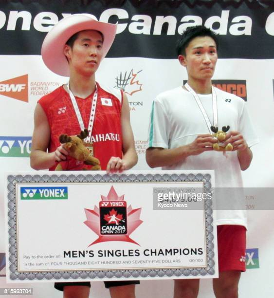 Japan's Kanta Tsuneyama and Kento Momota pose for a photo at the awards ceremony of the men's singles Canada Open badminton tournament in Calgary...