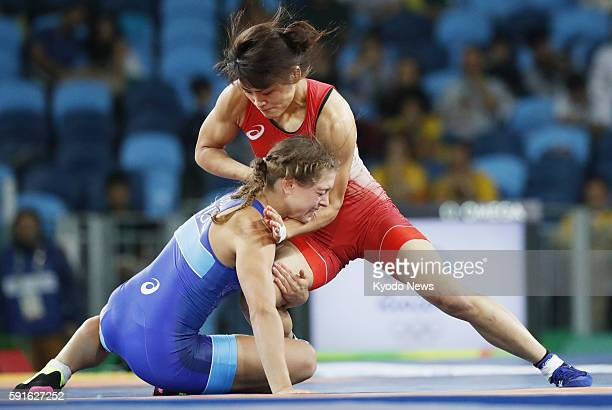 Japan's Kaori Icho competes against Valeriia Koblova Zholobova of Russia en route to winning the women's freestyle wrestling 58kilogram final at the...