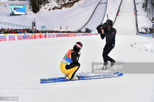 Japan's Kaori Iwabuchi reacts after her jump during the Ladies' team ski jumping event at the FIS Nordic World Ski Championships on February 26 2019...