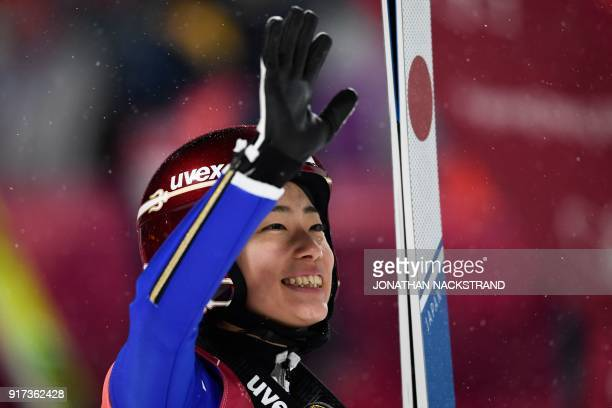 Japan's Kaori Iwabuchi waves as she competes in the women's normal hill individual ski jumping event during the Pyeongchang 2018 Winter Olympic Games...