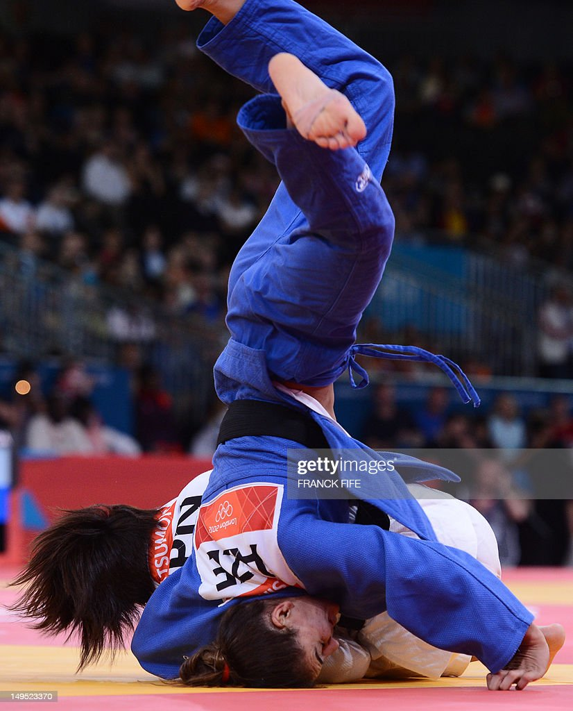 Japan's Kaori Matsumoto (white) competes with Azerbaijan's Kifayat Gasimova (blue) during their women's -57kg judo contest match of the London 2012 Olympic Games on July 30, 2012 ExCel arena in London.