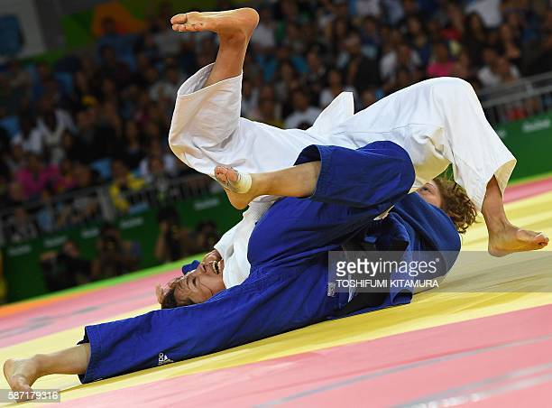 Japan's Kaori Matsumoto competes with France's Automne Pavia during their women's 57kg judo contest quarterfinal match of the Rio 2016 Olympic Games...