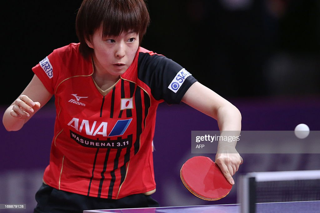 Japan's Kasumi Ishikawa competes during the third round of the Women's Singles of the World Table Tennis Championships in Paris on May 16, 2013. Japan's Kasumi Ishikawa plays against North Korea's Sun Ri Myong.