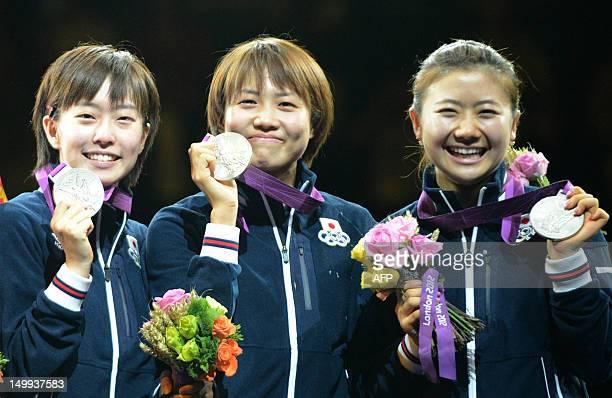 Japan's Kasumi Ishikawa Japan's Sayaka Hirano and Japan's Ai Fukuhara pose with their silver medals on the podium of the women's team table tennis...