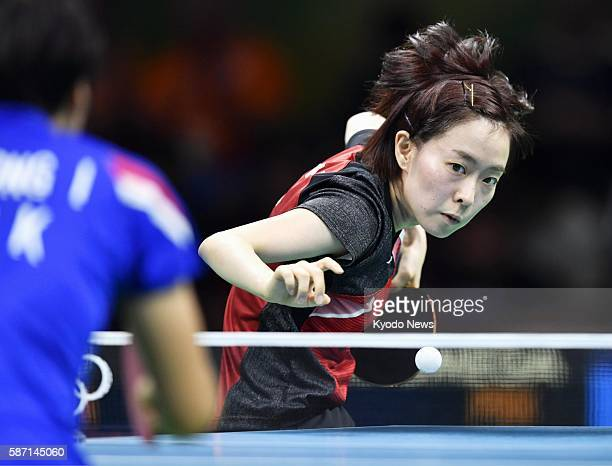 Japan's Kasumi Ishikawa plays against Kim Song I of North Korea at the third round of the women's table tennis singles competition at the Rio de...