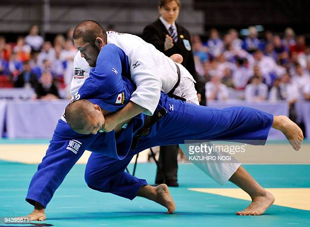 Japan's Kazuhiko Takahashi pushes out his compatriot Keiji Suzuki during their men's 100kg class final match at the Grand Slam Tokyo judo tournament...
