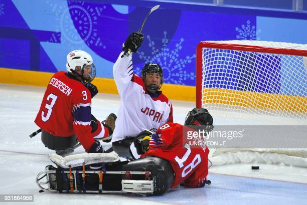 Japan's Kazuhiro Takahashi celebrates a goal against Norway's Kjell Christian Hamar during the ice hockey classification game between Norway and...