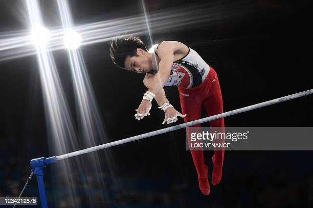 Japan's Kazuma Kaya competes in the horizontal bars event of the artistic gymnastics men's team final during the Tokyo 2020 Olympic Games at the...