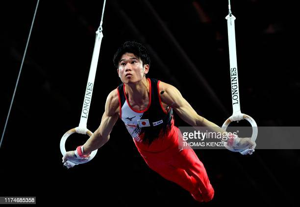 Japan's Kazuma Kaya performs on the rings during the men's team final at the FIG Artistic Gymnastics World Championships at the...