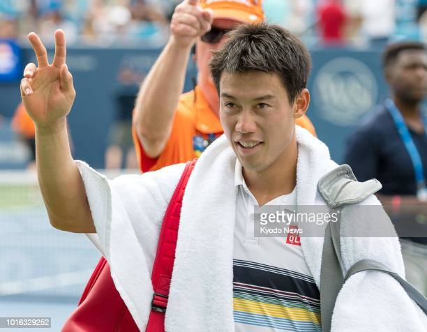 Japan's Kei Nishikori acknowledges the crowd after beating Russia's Andrey Rublev 75 63 in the first round of the Western amp Southern Open in...