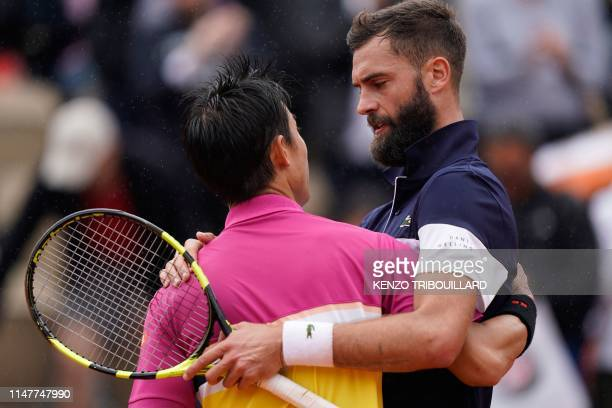 Japan's Kei Nishikori and France's Benoit Paire hug at the end of their men's singles fourth round match on day nine of The Roland Garros 2019 French...
