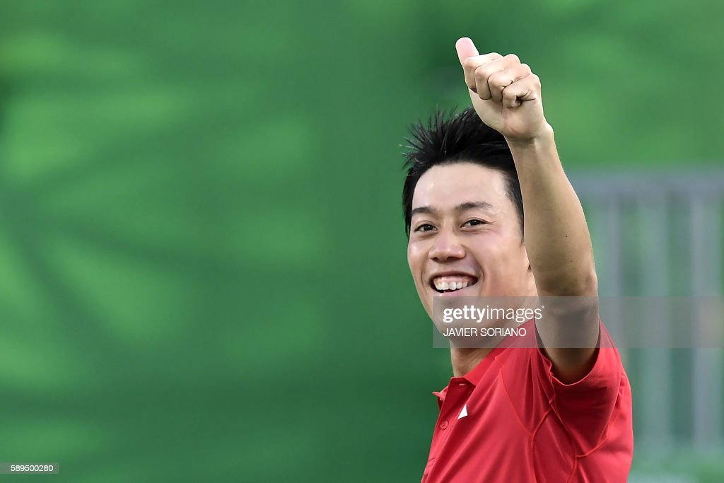 TOPSHOT - Japan's Kei Nishikori celebrates after beating Spain's Rafael Nadal in their men's singles bronze medal tennis match at the Olympic Tennis Centre of the Rio 2016 Olympic Games in Rio de Janeiro on August 14, 2016. /