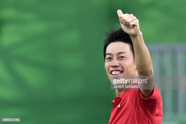 TOPSHOT Japan's Kei Nishikori celebrates after beating Spain's Rafael Nadal in their men's singles bronze medal tennis match at the Olympic Tennis...