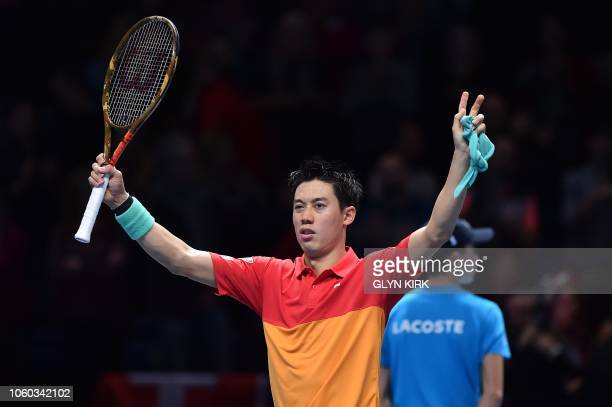 Japan's Kei Nishikori celebrates after beating Switzerland's Roger Federer 76 63 after their singles round robin match on day one of the ATP World...