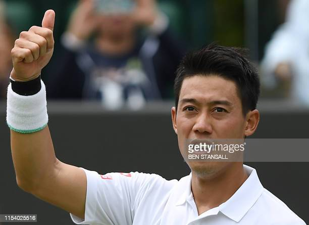 Japan's Kei Nishikori celebrates after beating US player Steve Johnson during their men's singles third round match on the sixth day of the 2019...