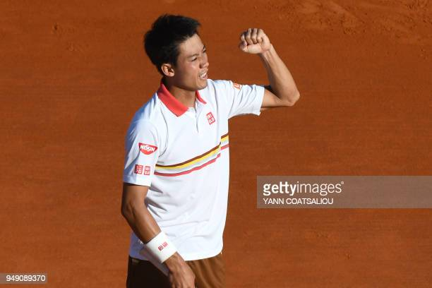 TOPSHOT Japan's Kei Nishikori celebrates after his victory against Croatia's Marin Cilic during their tennis match at the MonteCarlo ATP Masters...