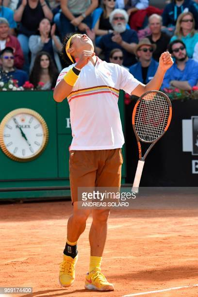 Japan's Kei Nishikori celebrates after winning his match against Bulgaria's Grigor Dimitrov during Rome's ATP Tennis Open tournament at the Foro...