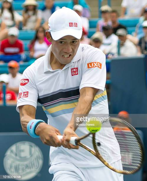 Japan's Kei Nishikori hits a backhand during a firstround match against Russia's Andrey Rublev at the Western amp Southern Open in Cincinnati Ohio on...