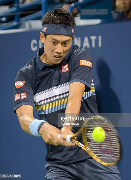 Japan's Kei Nishikori hits a backhand during a secondround match against Switzerland's Stan Wawrinka at the Western amp Southern Open in Cincinnati...