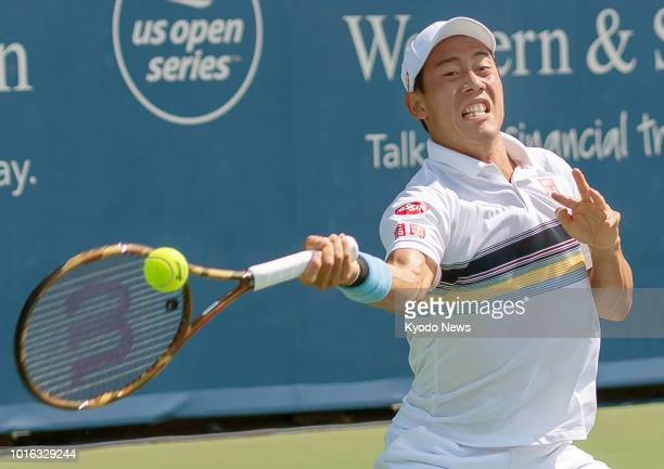 Japan's Kei Nishikori hits a forehand during a firstround match against Russia's Andrey Rublev at the Western amp Southern Open in Cincinnati Ohio on...