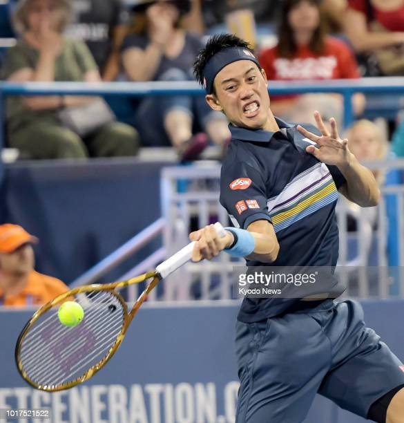 Japan's Kei Nishikori hits a forehand during a secondround match against Switzerland's Stan Wawrinka at the Western amp Southern Open in Cincinnati...