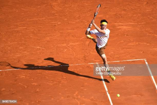 TOPSHOT Japan's Kei Nishikori hits a return to Croatia's Marin Cilic during their tennis match at the MonteCarlo ATP Masters Series tournament on...