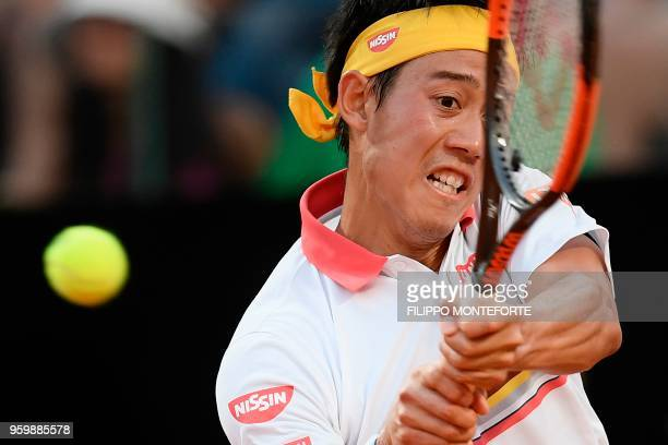 Japan's Kei Nishikori hits a return to Serbia's Novak Djokovic during their quarter final match at Rome's ATP Tennis Open tournament at the Foro...