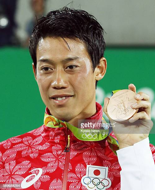 Japan's Kei Nishikori holds his bronze medal at the awards ceremony for the men's tennis tournament at the Rio de Janeiro Olympics on Aug 14 2016