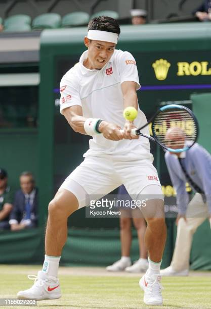Japan's Kei Nishikori in action against Roger Federer of Switzerland in their Wimbledon quarterfinal on July 10, 2019. ==Kyodo